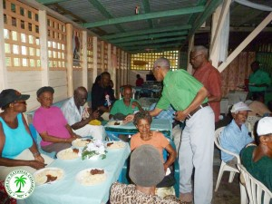 PNCR-Leader-assisting-in-serving-hot-meals-to-the-elderly-in-honour-of-Senior-Citizens-Month-at-New-Amsterdam